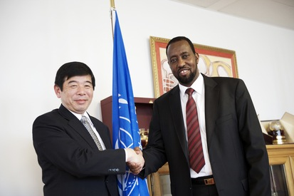 UPU Director General Bishar A. Hussein with World Customs Organization Secretary General Kunio Mikuriya