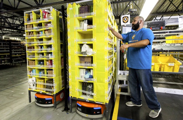 Amazon employee picking with robotics