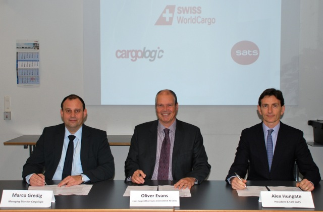 Marco Gredig of Cargologic  Oliver Evans of Swiss WorldCargo  and Alex Hungate of SATS  sign Memorandum of Understanding